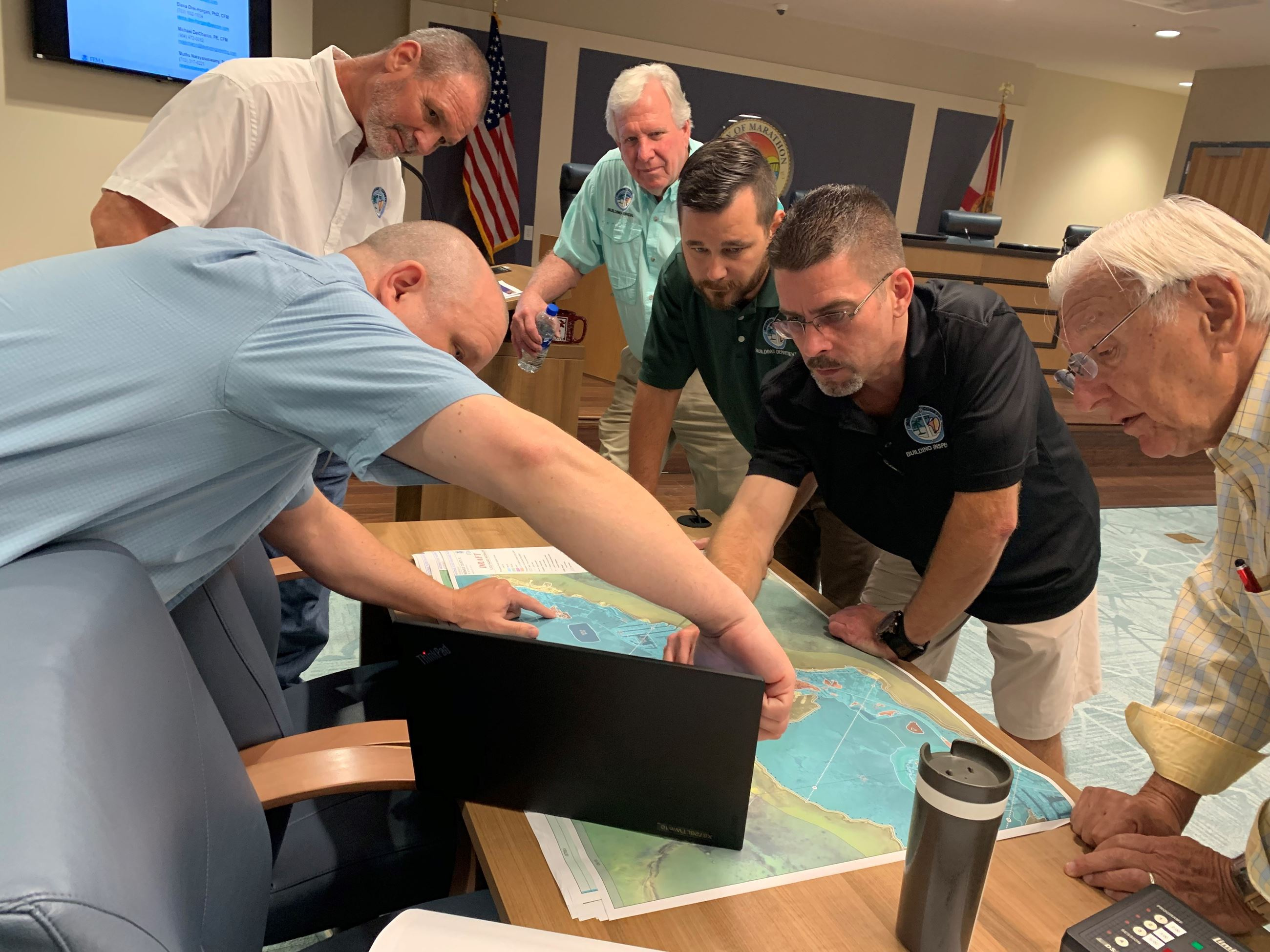 Monroe County Building Department looks over the newly released maps