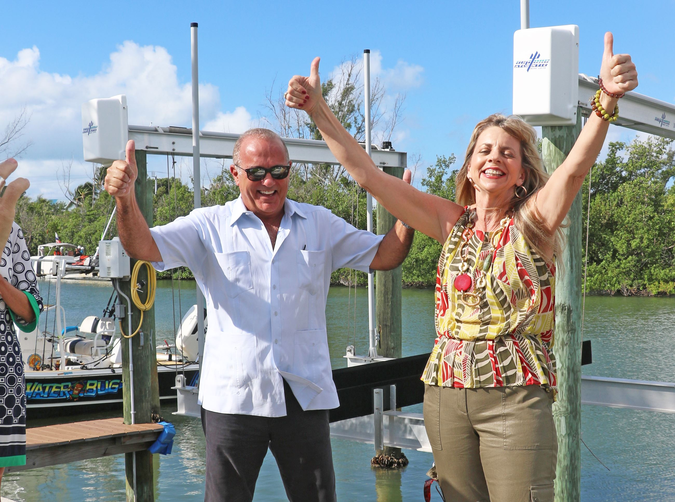 Rhonda Haag and Roman Gastesi celebrate at the last canal being cleared